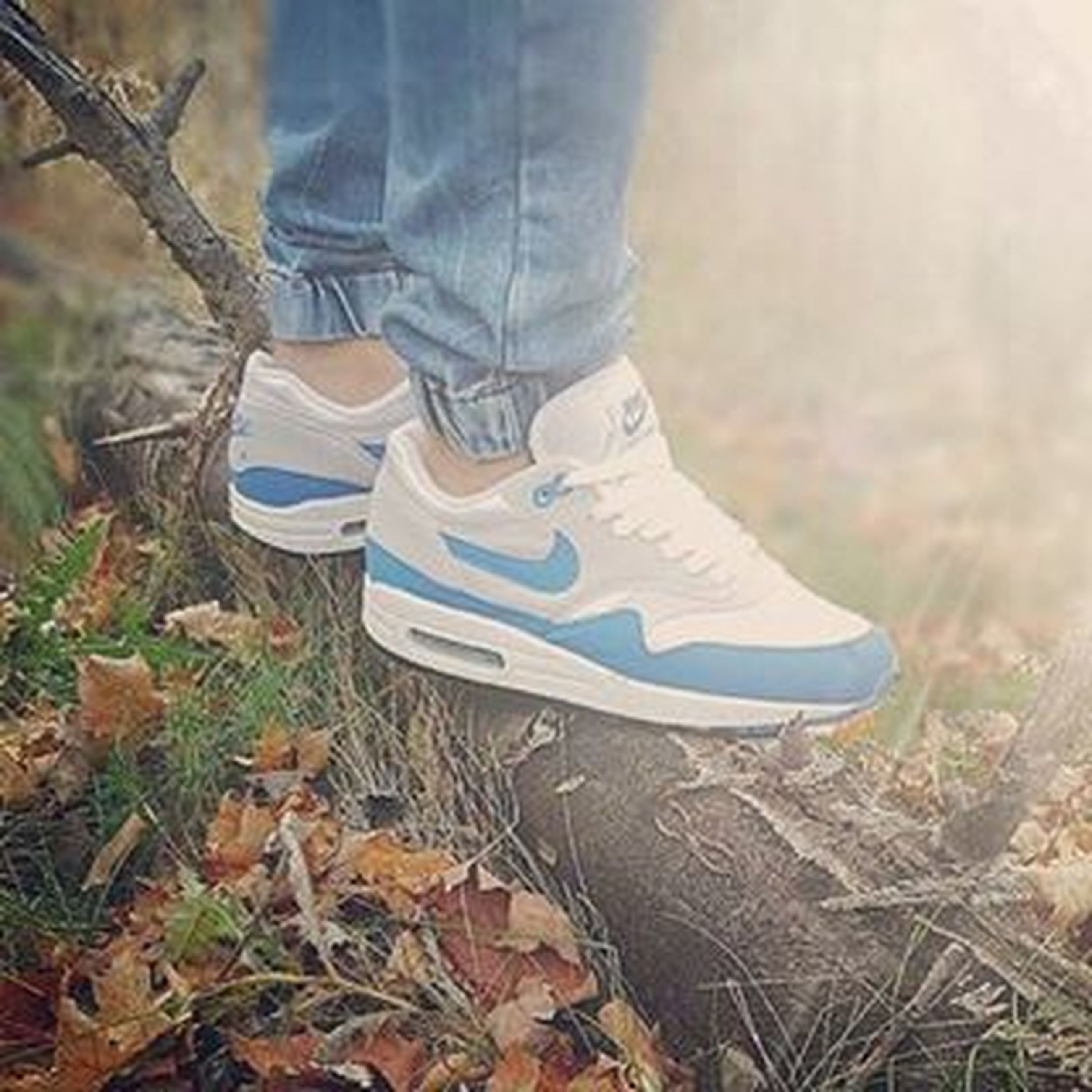focus on foreground, field, grass, close-up, day, one person, nature, shoe, outdoors, dry, leaf, forest, high angle view, plant, selective focus, low section, autumn, tranquility, messy, growth