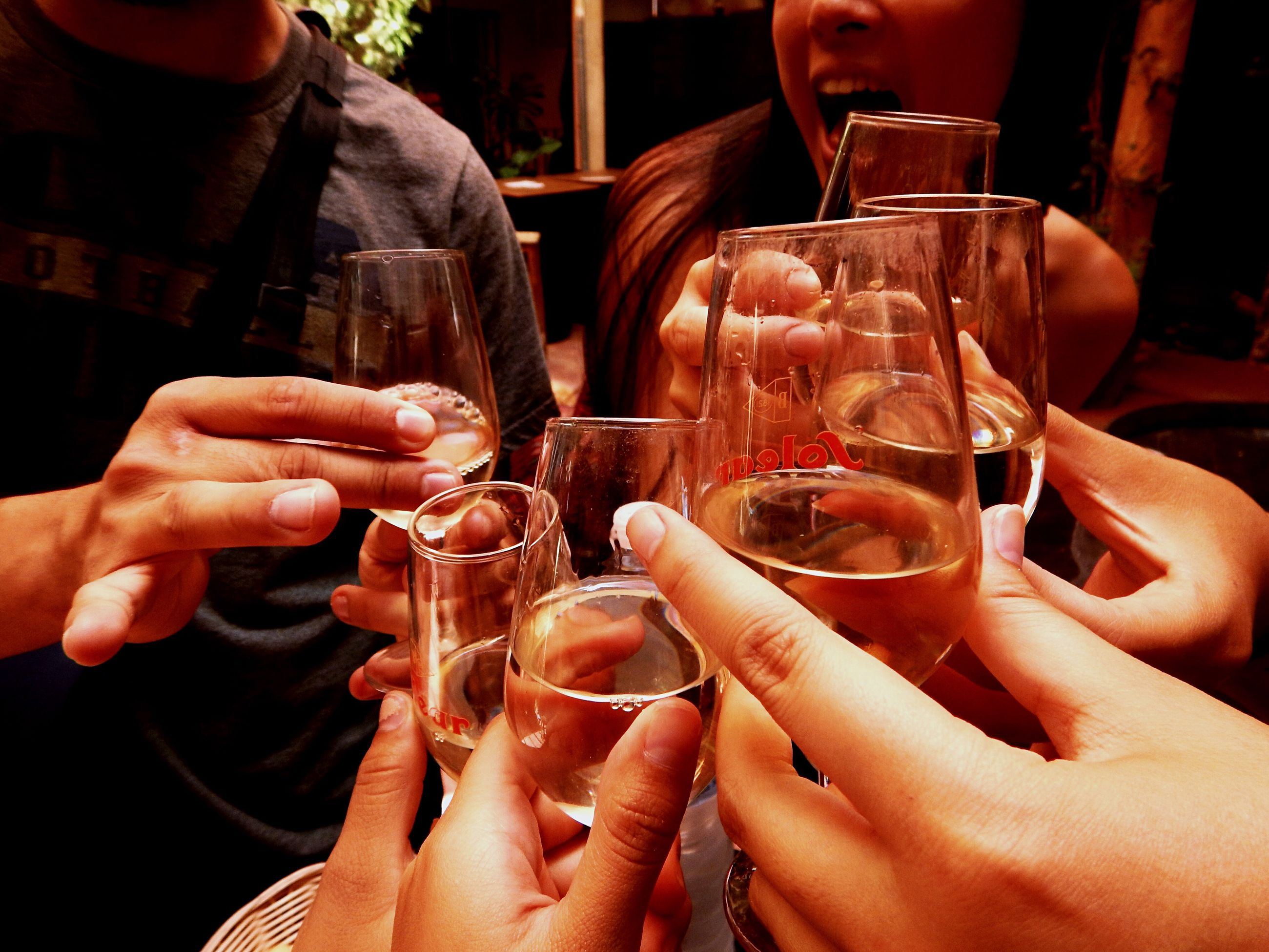 drink, food and drink, holding, alcohol, celebration, person, refreshment, wineglass, leisure activity, friendship, men, lifestyles, champagne, tradition, togetherness, close-up, restaurant, freshness, party - social event, in a row, nightclub, bar - drink establishment, nightlife