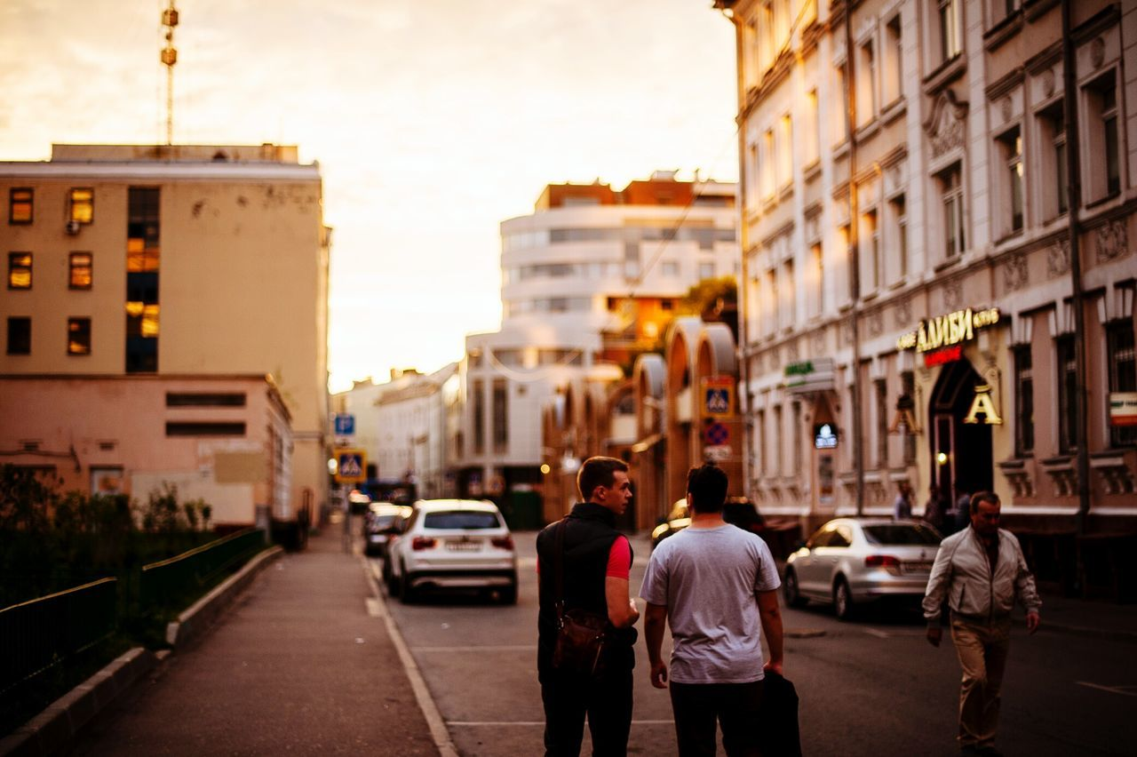 Building Exterior Architecture City Street City Street Group Of People Walking Men Road Car Outdoors Day Sunset Gold