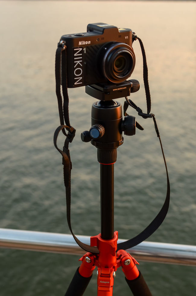 Digial camera on tripod with blured background (Nikon 1 V1 camera) Blurred Background Close-up Equipment Focus On Foreground Hobbies Nature Nikon Nikon 1  Nikon 1 V1 Nikon V1 Outdoors Photography Photography Themes Scenics Sea Sky Sunset Tourism Travel Travel Tri Pod Vacations View Water