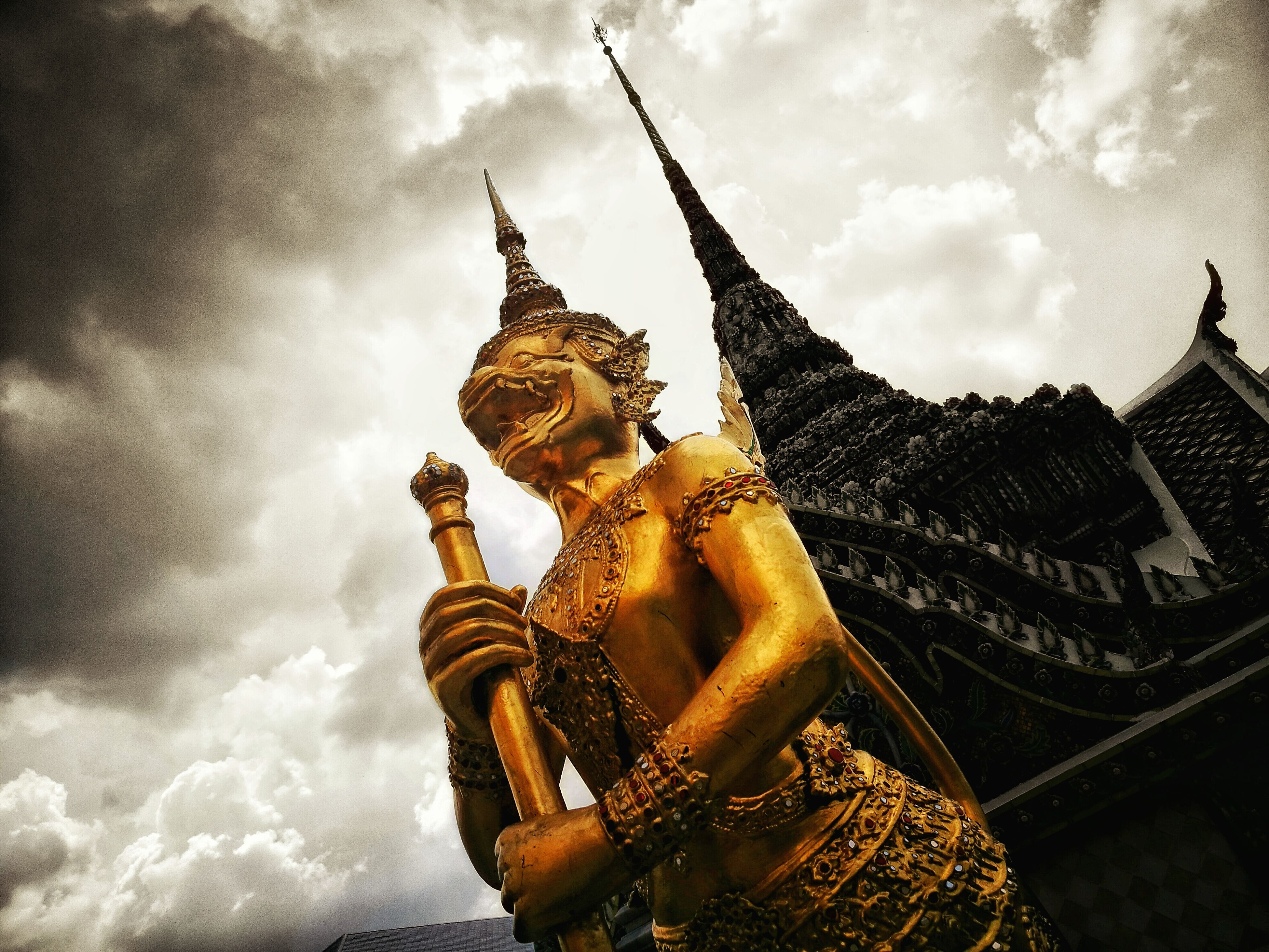 spirituality, religion, place of worship, gold colored, architecture, statue, human representation, sky, low angle view, built structure, sculpture, building exterior, cloud, cloud - sky, cloudy, gold, outdoors, church, golden, creativity, day, sunbeam, famous place, spire, tourism