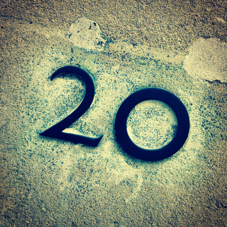 house number 20 on a concrete wall 20 Asphalt Circle Close-up Concrete Day Directly Above Door Number Geometric Shape High Angle View Metal No 20 No People Outdoors Road Shadow Single Object Still Life Street Sunlight Textured