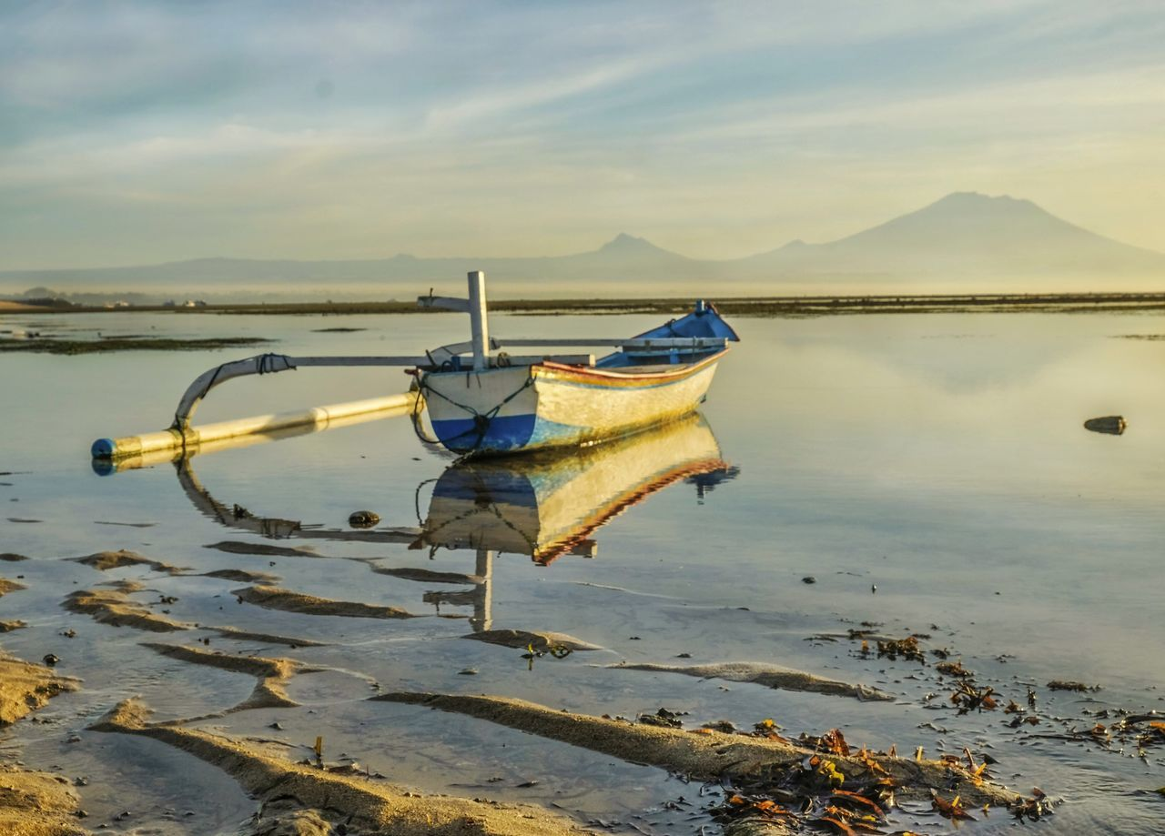 water, nautical vessel, transportation, nature, moored, no people, sky, mode of transport, tranquil scene, outdoors, beach, scenics, beauty in nature, day, sea, horizon over water