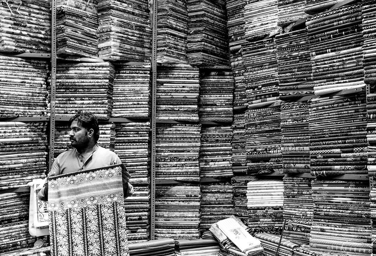 Dubai Urban Black & White Lines Texture Photography Fabric Real Person Store Seller Market Emirates Portrait Man Portrait Of A Man  Geometric Geometric Lines Pattern Large Group Of Objects Indoors  Travel People Day The Portraitist - 2017 EyeEm Awards The Street Photographer - 2017 EyeEm Awards
