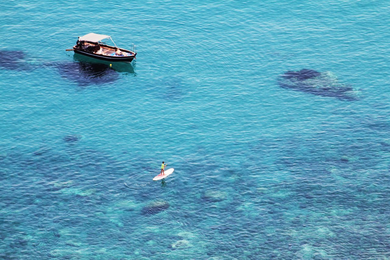 Sea Boat Seascape View From Above Paddle Paddleboarding Paddle Boarding Paddle Surf Sports Holiday Crystal Clear Waters Blue Sea Blue Water Travel Travelling Color Palette Popular Photos EyeEm Best Shots Hidden Gems  Finding New Frontiers Flying High Taormina Isola Bella Sicily Italy MISSIONS: The Great Outdoors - 2017 EyeEm Awards The Portraitist - 2017 EyeEm Awards