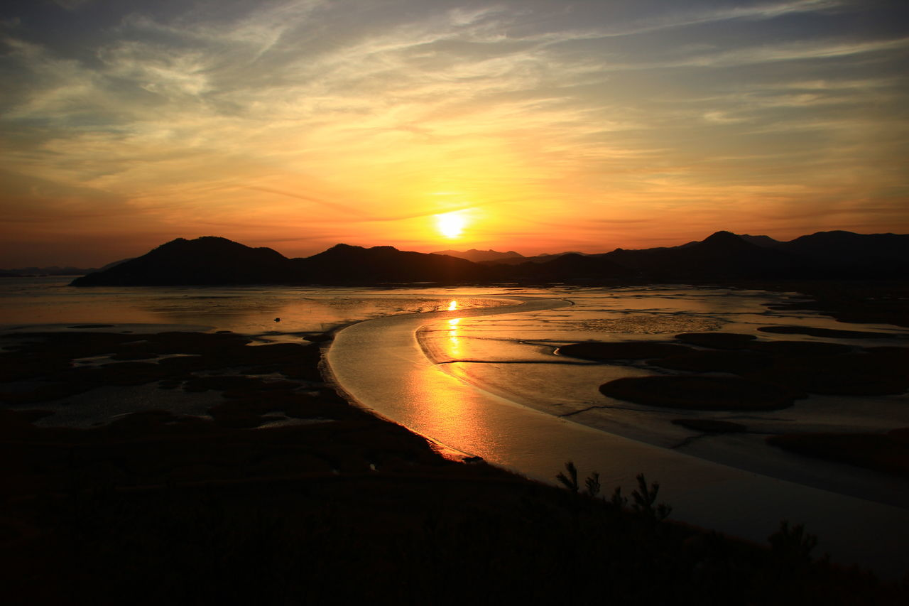 Suncheonman Bay sunset Atmosphere Atmospheric Mood Bay Beauty In Nature Clouds Korea Magic Hour Mud Flat Shore Suncheonman Bay Sunset Tranquil Scene Travel Vacations