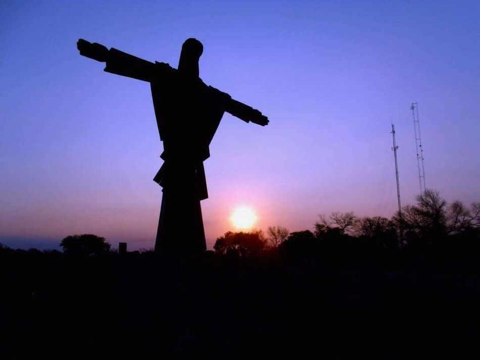Redentor De Los Montes Silhouette Statue Human Representation History Cross Sculpture Sunset Sky Outdoors No People Day