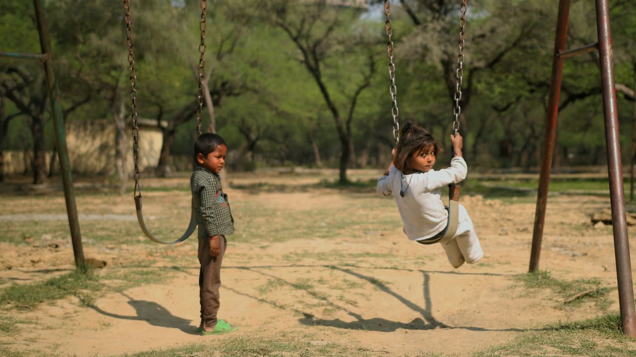 Indian Kid Playing Childhood Swinging Kids Being Kids Kids Having Fun Kids Photography Streetphotography First Eyeem Photo Swing Swing Swing Kids Playing In Park