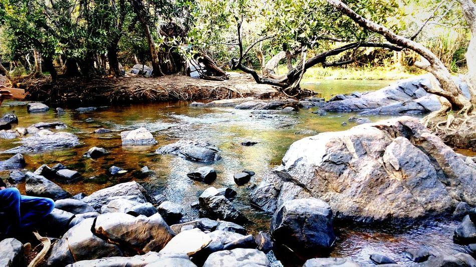 Pastel Power Water Over Rocks