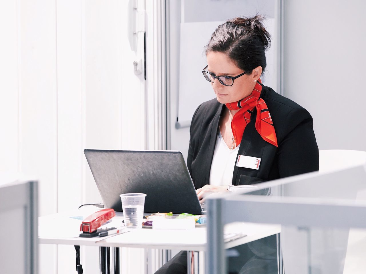 Business woman using laptop Wireless Technology Technology Laptop Using Laptop Computer Communication Business Connection Business Finance And Industry Office Businesswear Businesswoman One Person Internet Working Business Person Manager Corporate Business Professional Suit