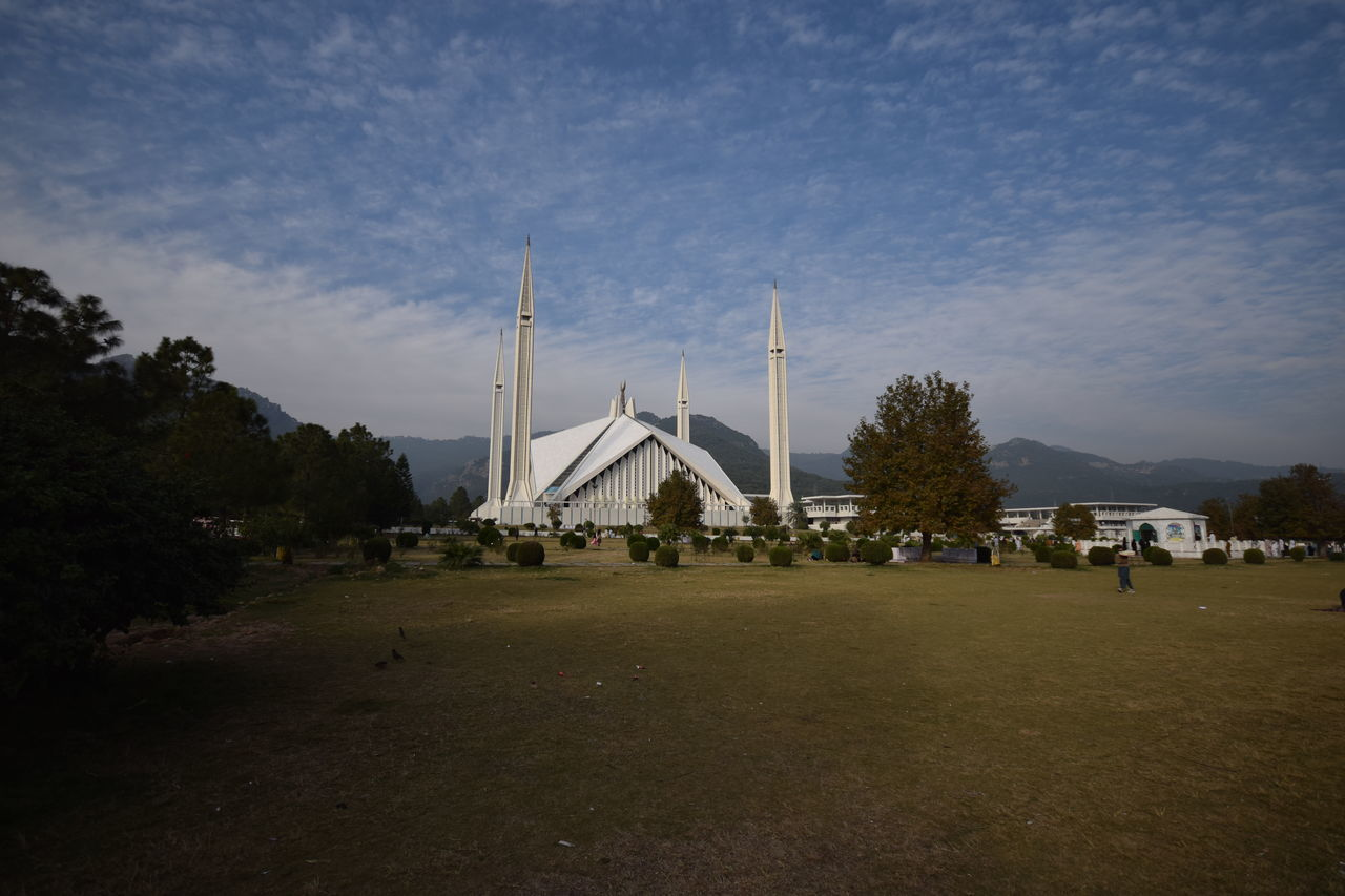 Faisal Masjid/Mosque Architecture Blue Built Structure Cloud Cloud - Sky Cloudy Day Faisal Masjid Faisal Mosque Grass Landscape Masjid Mosque Nature No People Outdoors Praying Place Sky Tourism Travel Destinations Tree