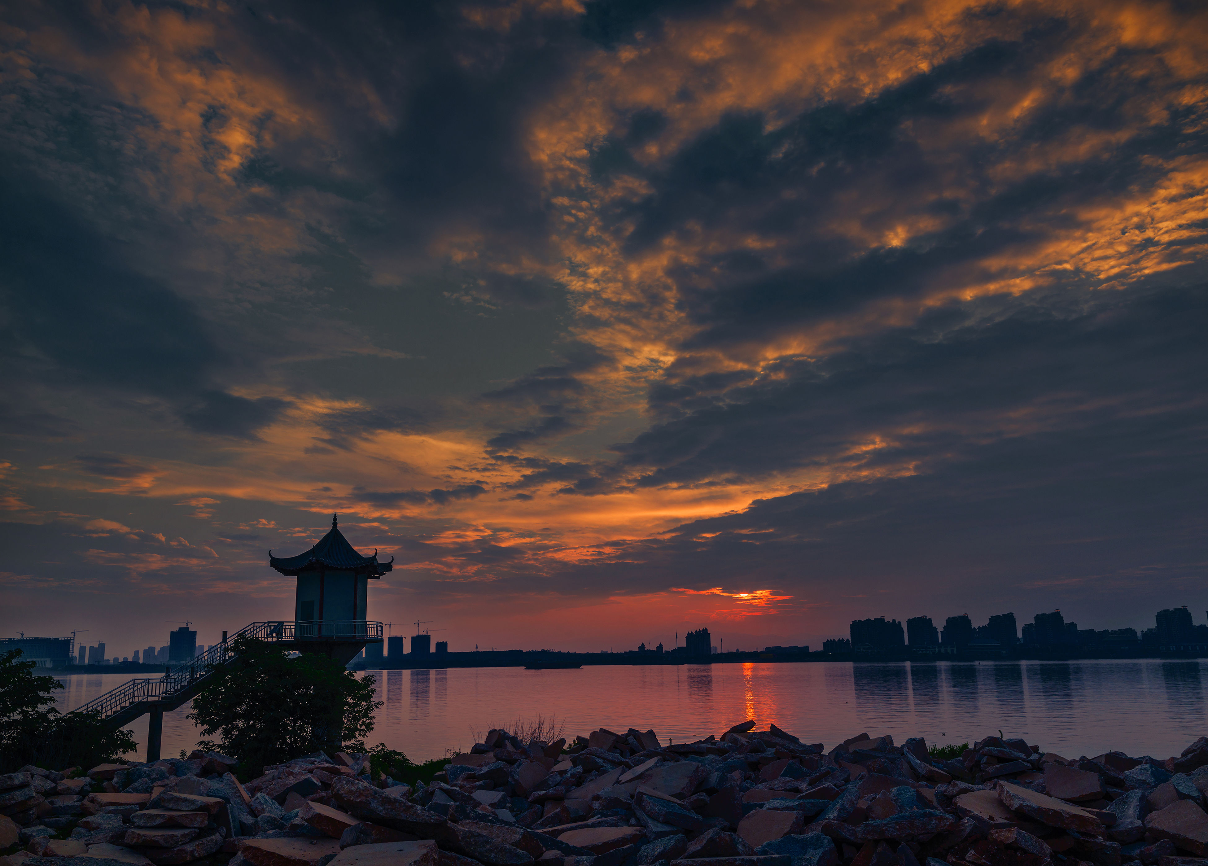 sunset, sky, cloud - sky, water, orange color, built structure, architecture, building exterior, cloudy, scenics, beauty in nature, tranquility, nature, lighthouse, cloud, tranquil scene, idyllic, silhouette, sea, dramatic sky