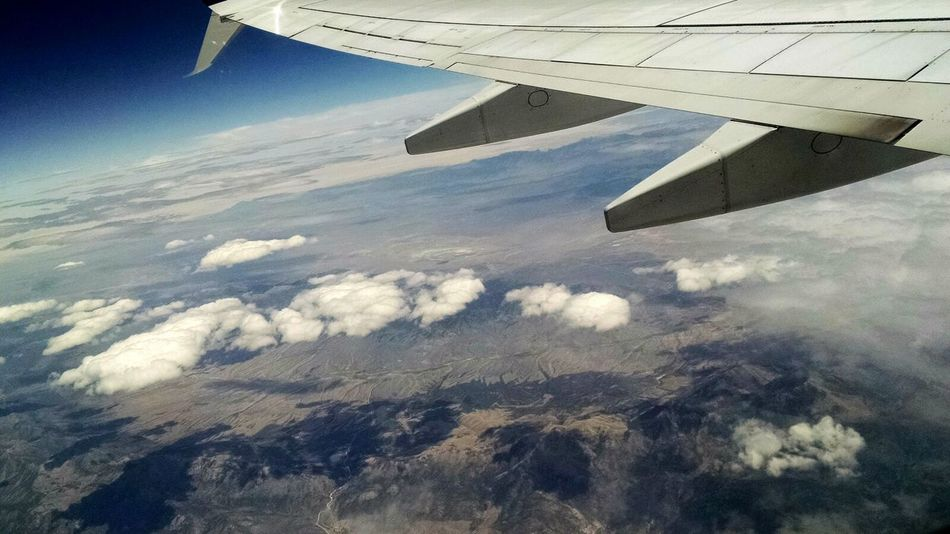 On The Way Flight Wings Flight Aerial Shot Aerial View IPhone Window View Flight Window Clouds And Sky Aeroplane Window View Travel Travel Photography Plane Landscape Popular Nature Adventure Club Showcase July Fine Art Photography Blue Sky Colour Of Life A Bird's Eye View Traveling Home For The Holidays