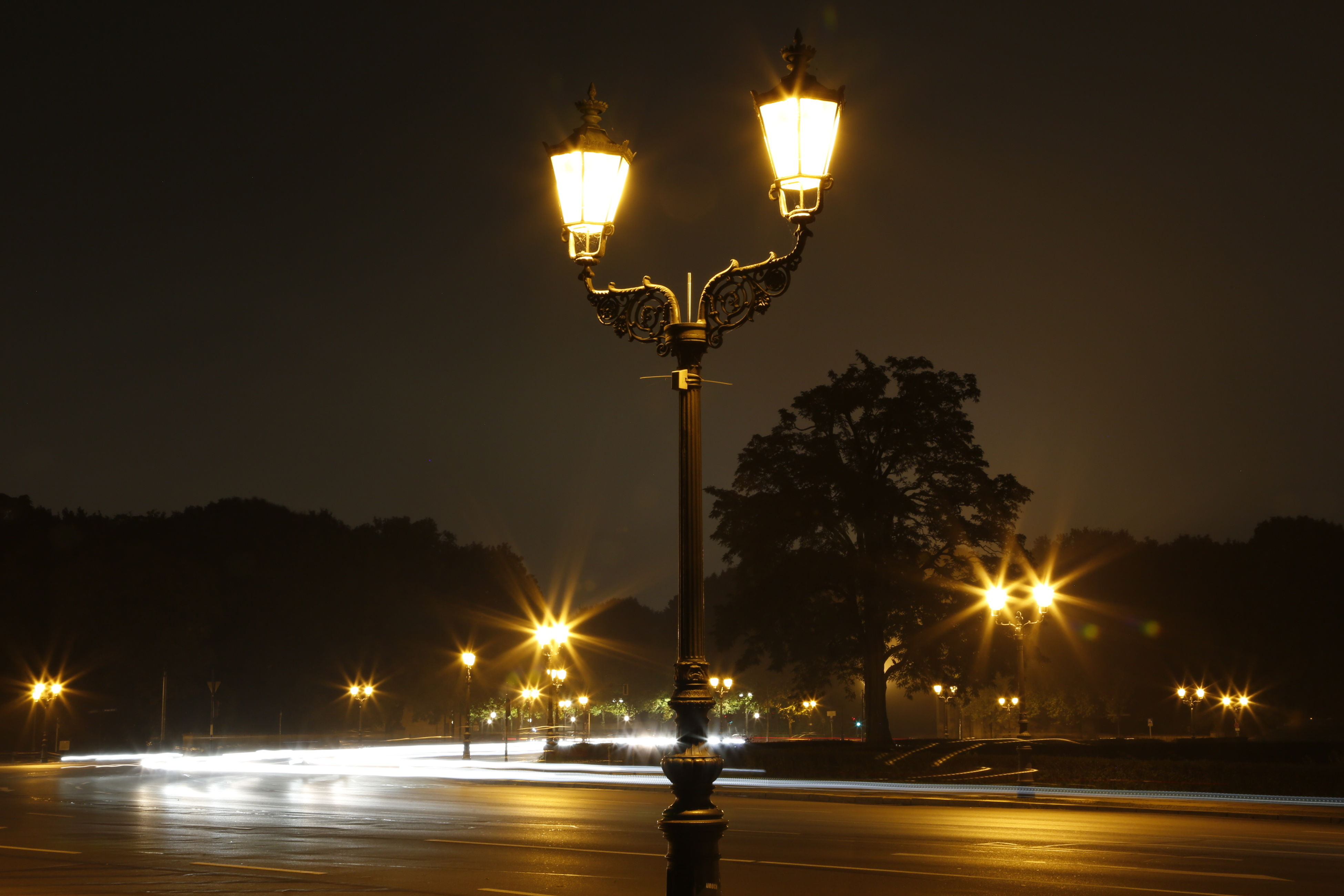 illuminated, night, street light, lighting equipment, electricity, glowing, electric light, sky, lit, street, light - natural phenomenon, dark, road, transportation, long exposure, lamp post, low angle view, outdoors, no people, in a row