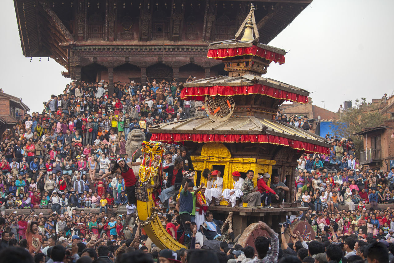 Bisket Jatra, the annual celebration of two of the most important deities of the ancient city of Bhaktapur, Nepal. A huge and ponderous chariot carrying image of the god Bhairab is hauled by hundreds of villagers to Khalna Tole, a moment of danger and excitement. Audience Bhaktapur Bisketjatra Celebration Ceremony Chariot Competition Crowd Cultures Festival Large Group Of People Lifestyles Men Nepal Outdoors People Place Of Worship Religion Tradition Travel Travel Destinations Women