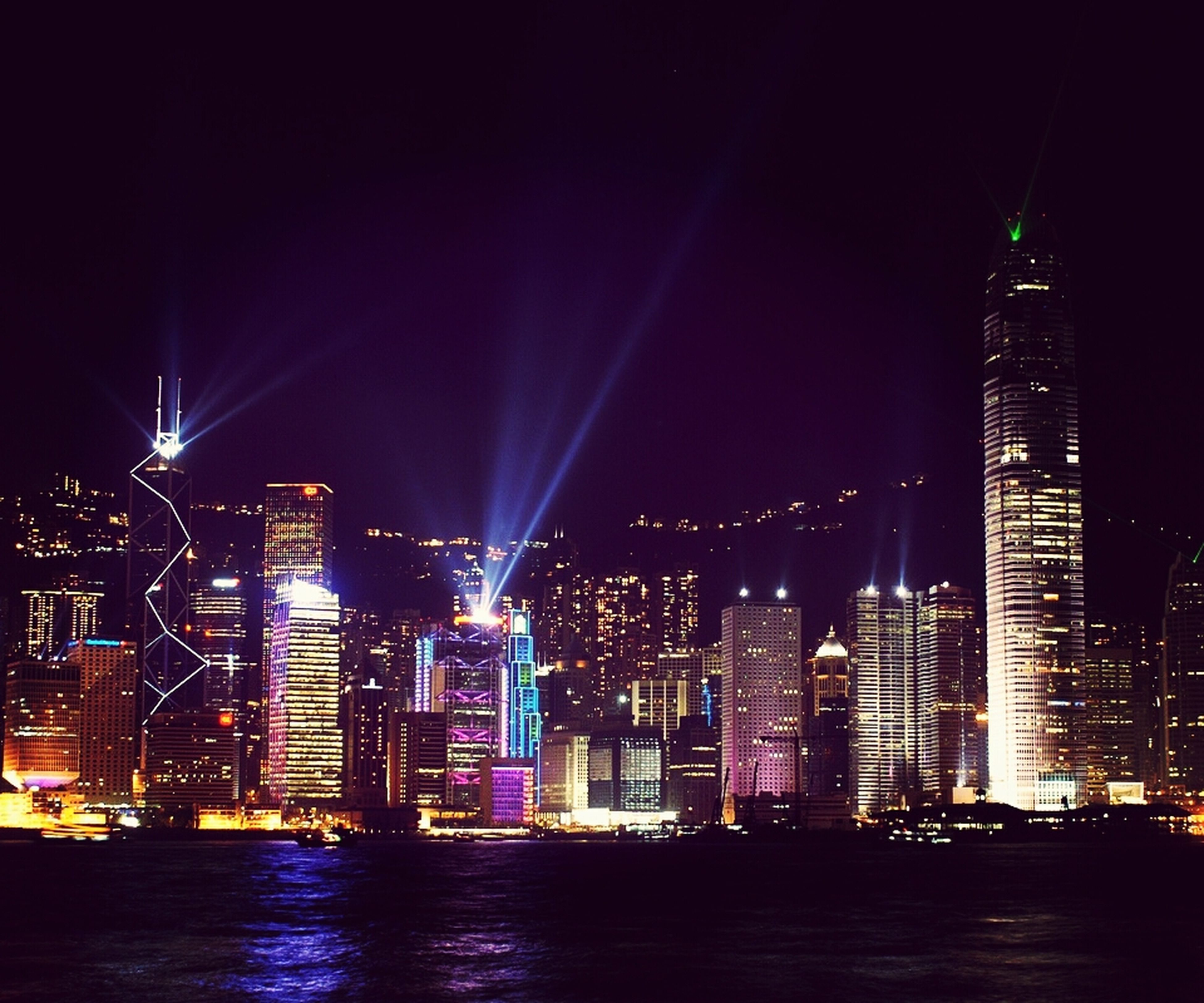 illuminated, night, architecture, building exterior, city, built structure, skyscraper, cityscape, modern, office building, urban skyline, tall - high, tower, waterfront, financial district, river, capital cities, sky, city life, water