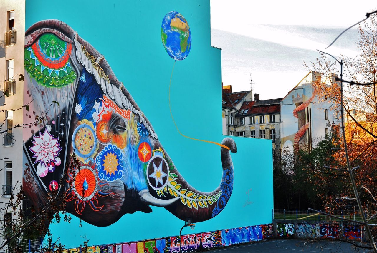 elephant: jadore tong aka S.Y.R.U.S Architecture Berlin Berlin Photography Berlin Streetart Berliner Ansichten Building Exterior Colorful Day Elephant Jadore Tong Aka S.Y.R.U.S Joy Lifestyle Lifestyles Multi Colored No People Outdoors Playful Spiritual Spirituality Street Streetart Urban Art Vibrant Color Wall Wall Art
