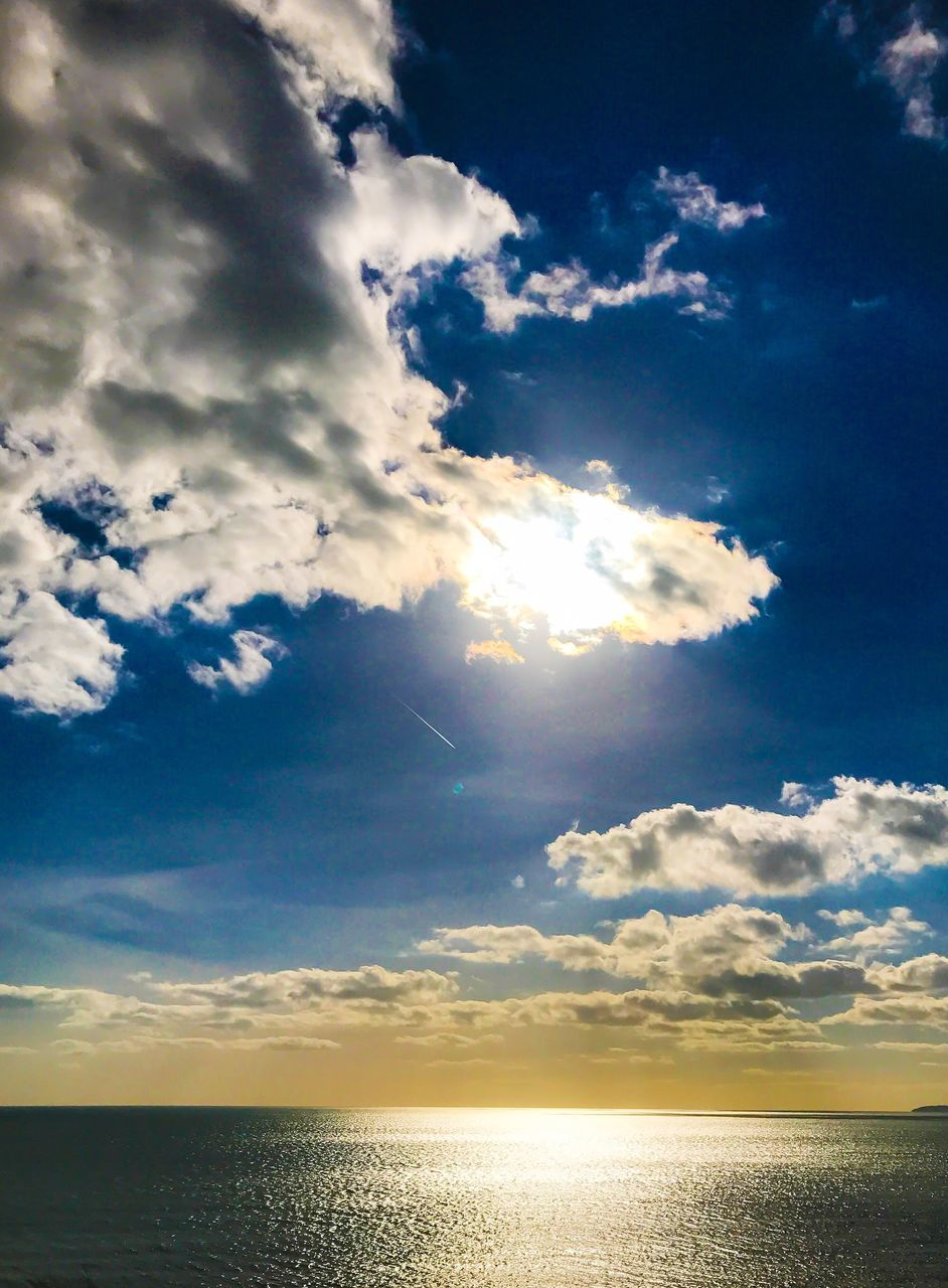 scenics, sky, cloud - sky, tranquil scene, nature, tranquility, beauty in nature, sunbeam, horizon over water, sea, sun, sunlight, water, idyllic, reflection, sunset, outdoors, no people, day