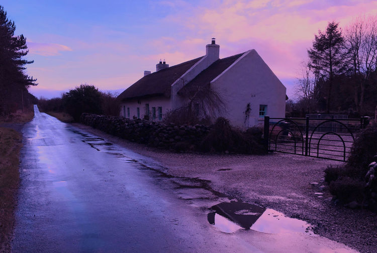 Showcase: January Winter Ireland Cottage Thatched Roof Red Blue Trees Road Perspective Distant Puddle Reflection Reflection_collection Landscape_Collection Landscape Life Time To Reflect Stepbackintime Stone IPhoneography
