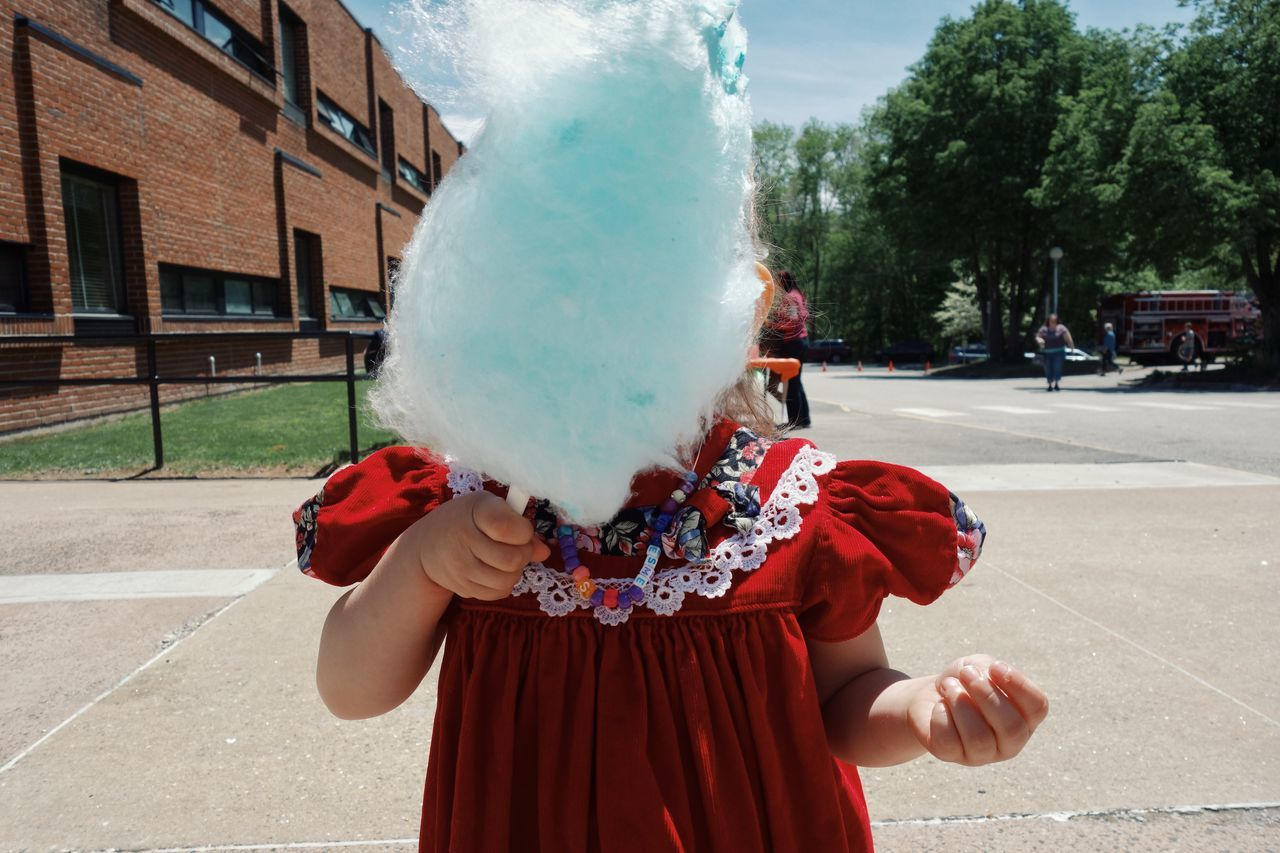Blue cotton candy at the summet fair. One Person Front View Outdoors Standing Leisure Activity Cottoncandy Cotton Candy! Summer Festival Blue Child Childhood Junk Food Fair Food Live For The Story Lifestyles