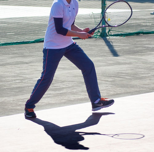 Activity Adults Only Athlete Ball Court Exercising Healthy Lifestyle Leisure Activity Lifestyles Motion One Person One Woman Only Playing Practicing Racket Recreational Pursuit Relaxation Exercise Serving - Sport Sport Sports Clothing Sports Training Taking A Shot - Sport Tennis Tennis Racket Vitality