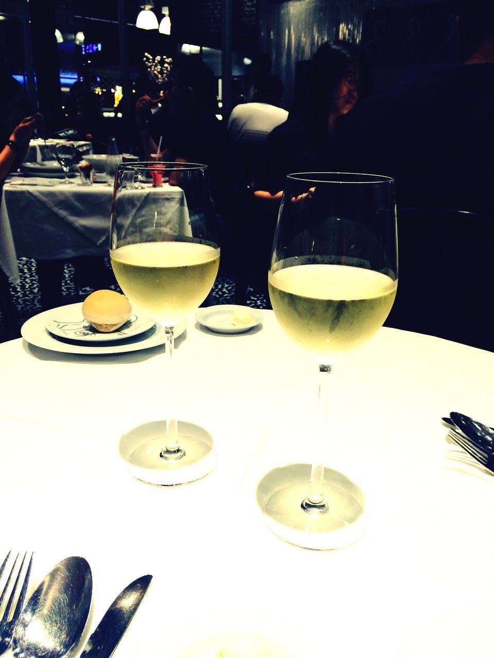 table, food and drink, wineglass, restaurant, wine, drink, refreshment, alcohol, drinking glass, plate, real people, indoors, two people, sitting, freshness, men, food, close-up, day, people