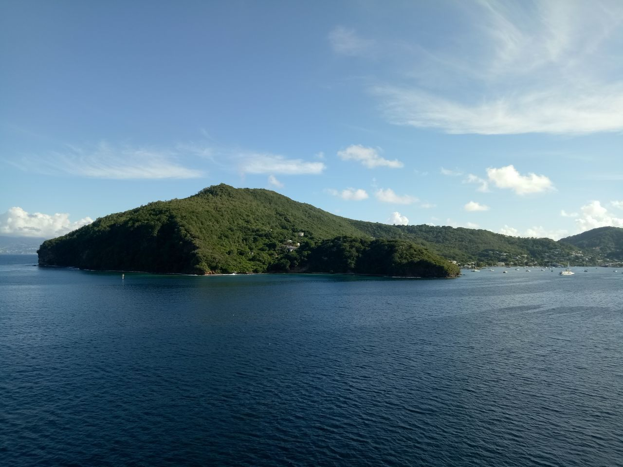 Bequia Water Tree Scenics Blue Landscape Lake Rippled Social Issues Sky Tranquil Scene Nature No People Cloud - Sky Beauty In Nature Day Outdoors Mountain travel destinations
