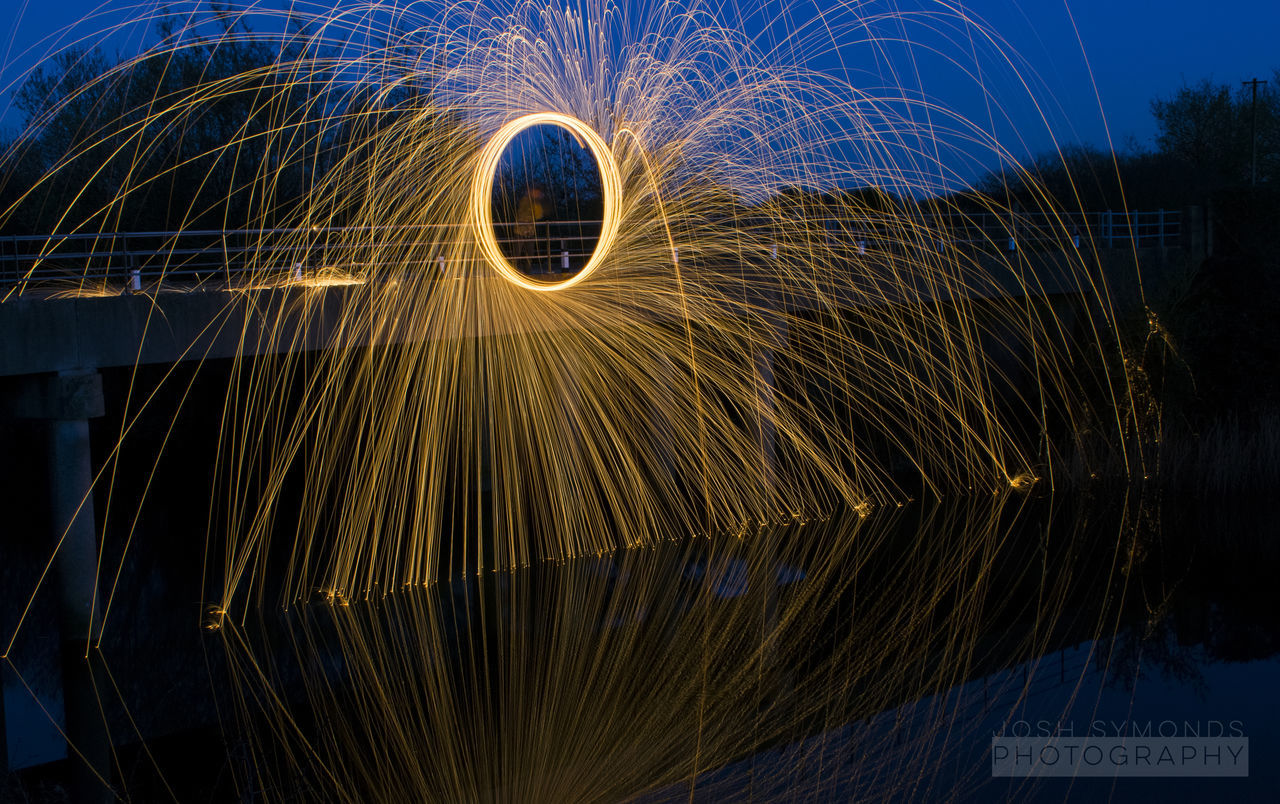 Steel wool reflections Abstract Blue Glowing Illuminated Light Trails Night Outdoors Reflection Sparks Sparks Fly Spinning Steel Wool Water Water Reflections