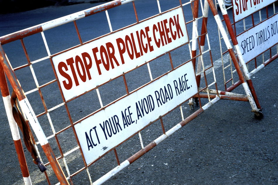 Close-up Communication Day Fence Metal No People Outdoors Police Check Police Sign Police Stop Road Road Sign Text