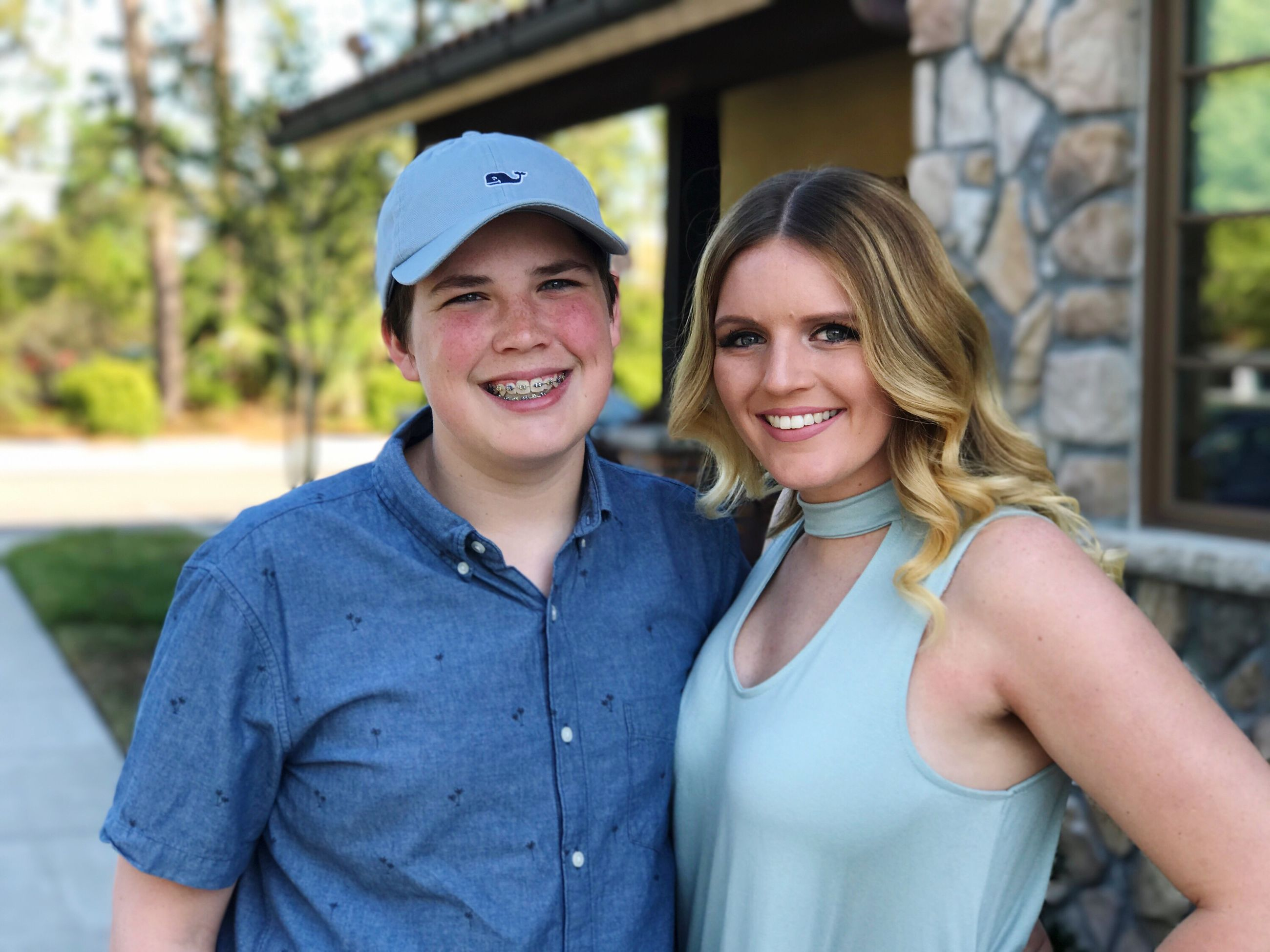 smiling, happiness, togetherness, portrait, two people, looking at camera, adults only, love, toothy smile, blond hair, friendship, bonding, people, outdoors, adult, leisure activity, women, baseball cap, young women, cheerful, day, standing, young adult, only women