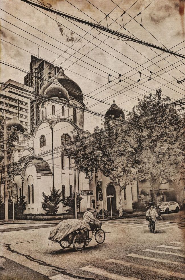 Old picture From My Point Of View My City My Street Photography Atmosphere Shanghai My Streetphotogray Taking Photos Streetphotography Transportation Bicycle Roadside In Front Of Church Arch Sky