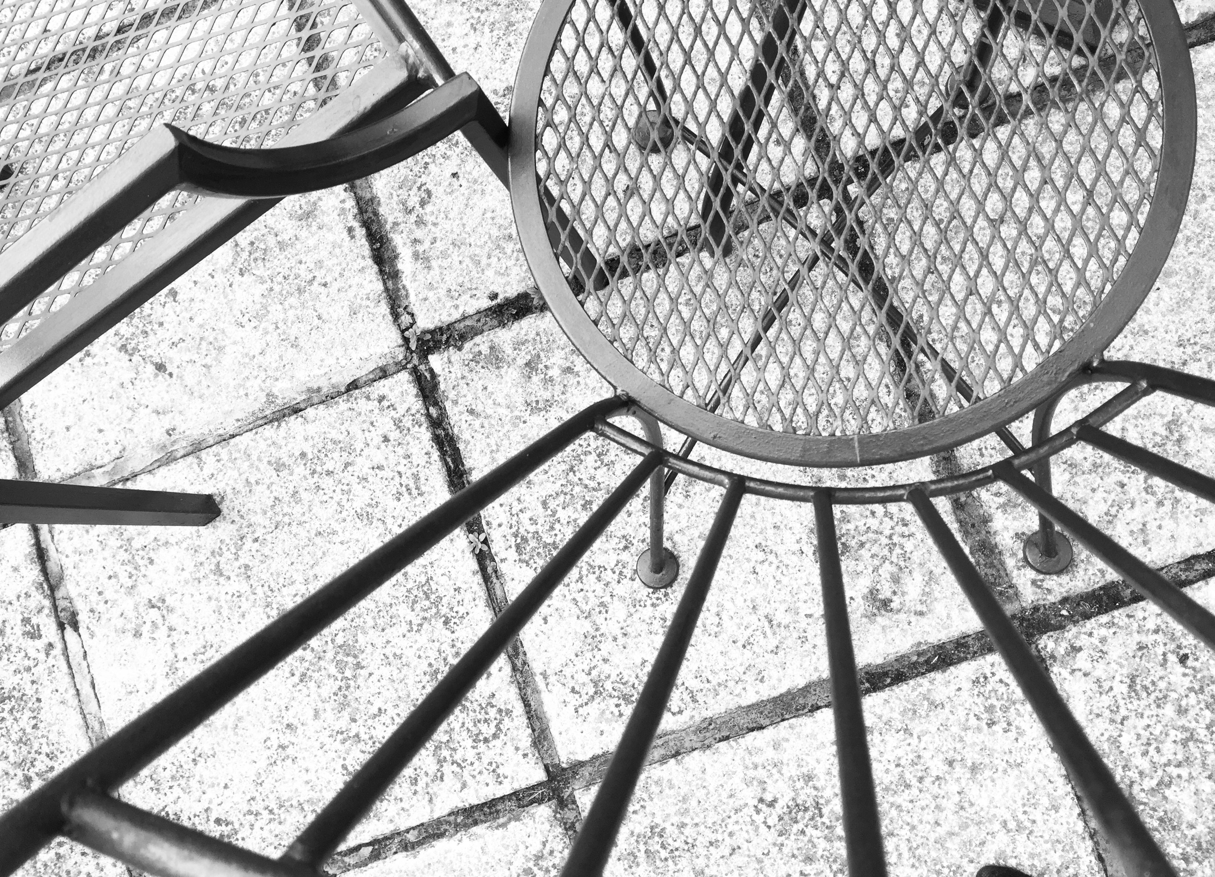 metal, pattern, shadow, indoors, design, high angle view, railing, sunlight, metallic, close-up, geometric shape, no people, day, protection, shape, circle, absence, steps, built structure