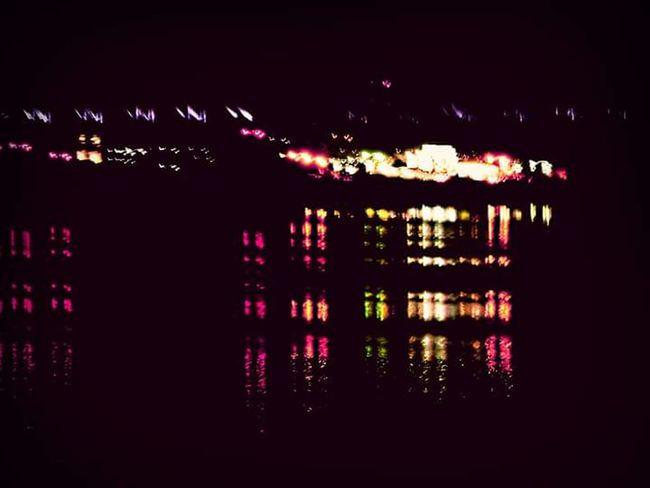Illuminated Reflection Window Lighting Equipment Night Dark Water Electric Light Multi Colored No People Lit Bridge Bridge - Man Made Structure Clarksville,Tennessee