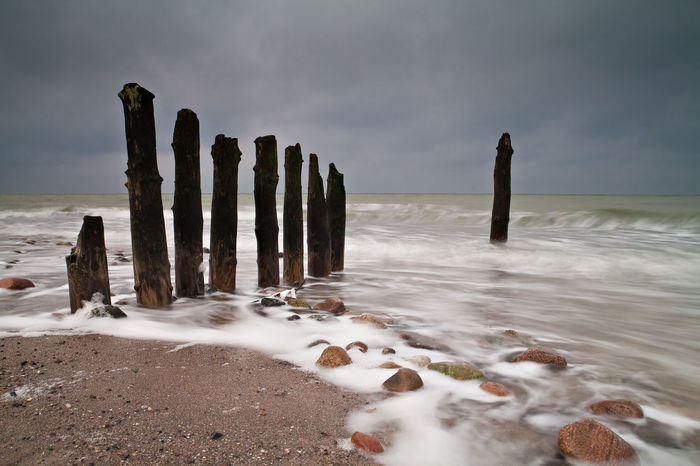 Groyne on shore of the Baltic Sea. Baltic Sea Beach Beauty In Nature Calm Cloud - Sky Coastline Day Groyne Horizon Over Water Kühlungsborn Majestic Nature Non-urban Scene Outdoors Sand Scenics Sea Shore Sky Stones Tranquil Scene Tranquility Water Wave Wooden Post