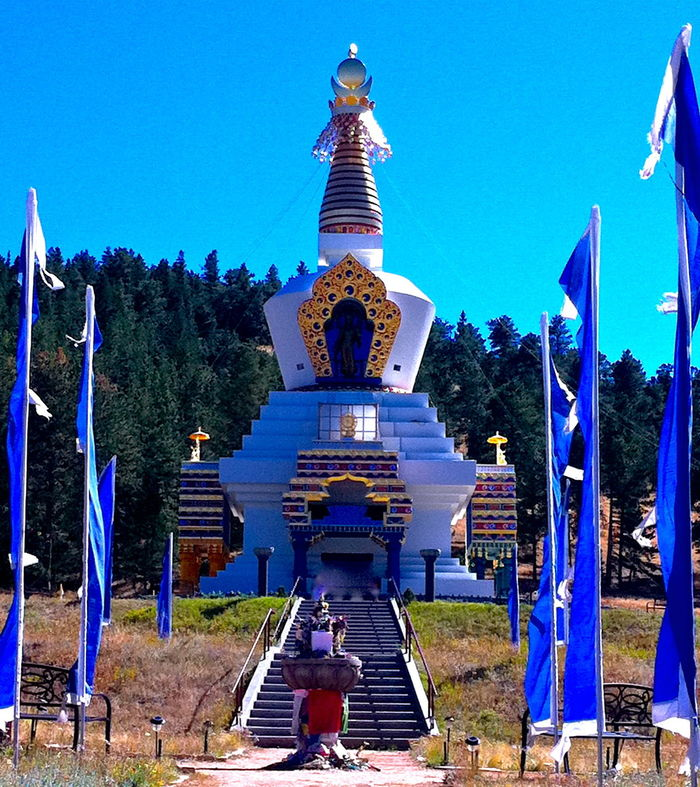 Blue Built Structure Casual Clothing Clear Sky Day Full Length Leisure Activity Lifestyles Men Person Rear View Relaxation Stupa Sunlight Thatched Roof Tourism Tourist Tree Vacations