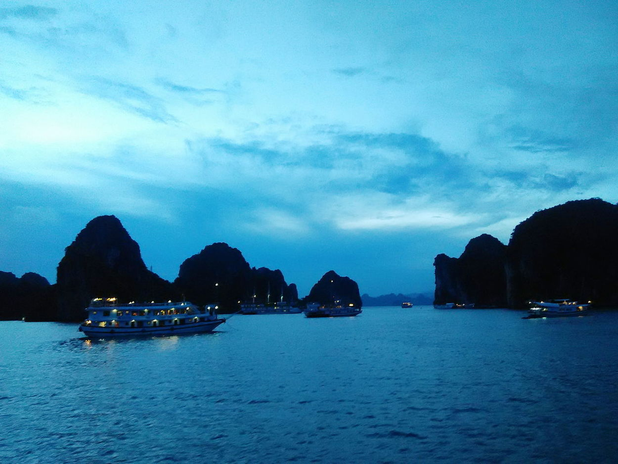 Into the blue Cruiseships On Board Boat Beauty In Nature Rock - Object Scenics Outdoors Night Lights Nightphotography Travel Destinations Calm Water Ha Long Bay Cruise Halong Bay Vietnam The Week On EyeEm Tranquility This Week On EyeEm. Eye Em Selects
