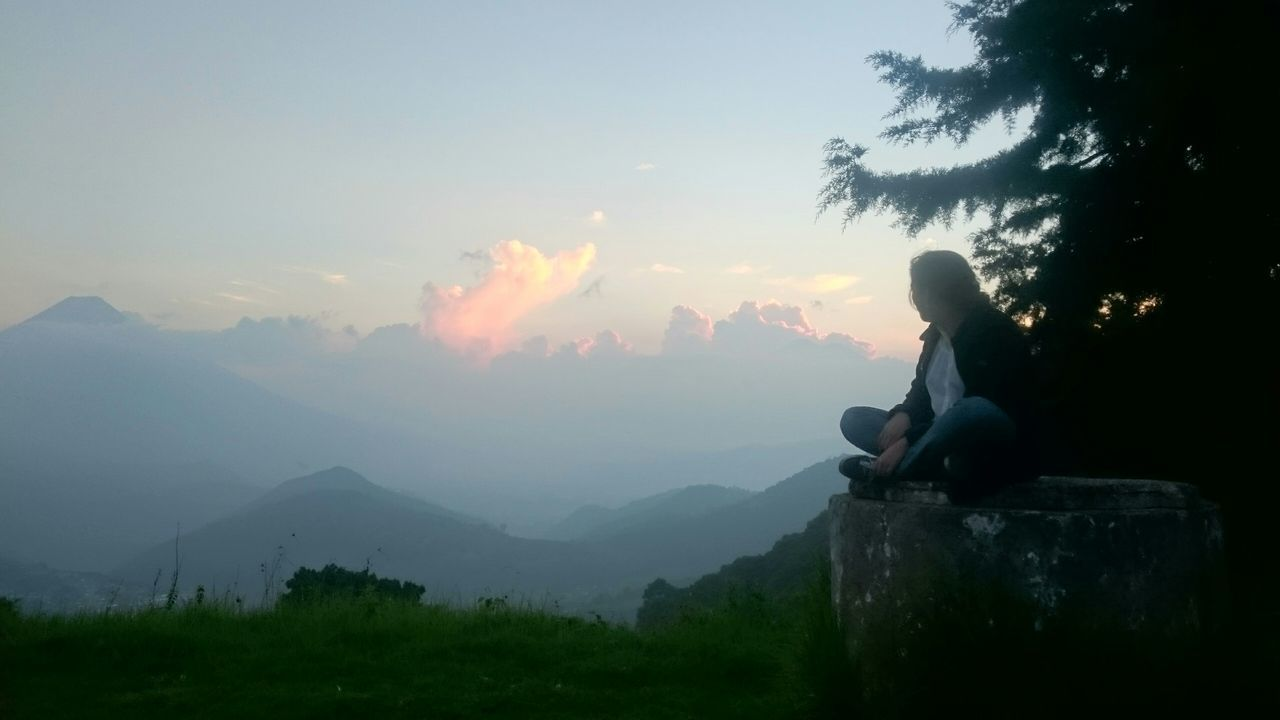 real people, nature, mountain, beauty in nature, one person, outdoors, sky, scenics, tranquil scene, tranquility, sitting, cloud - sky, tree, full length, day, sunset, lifestyles, women, young women, young adult, people