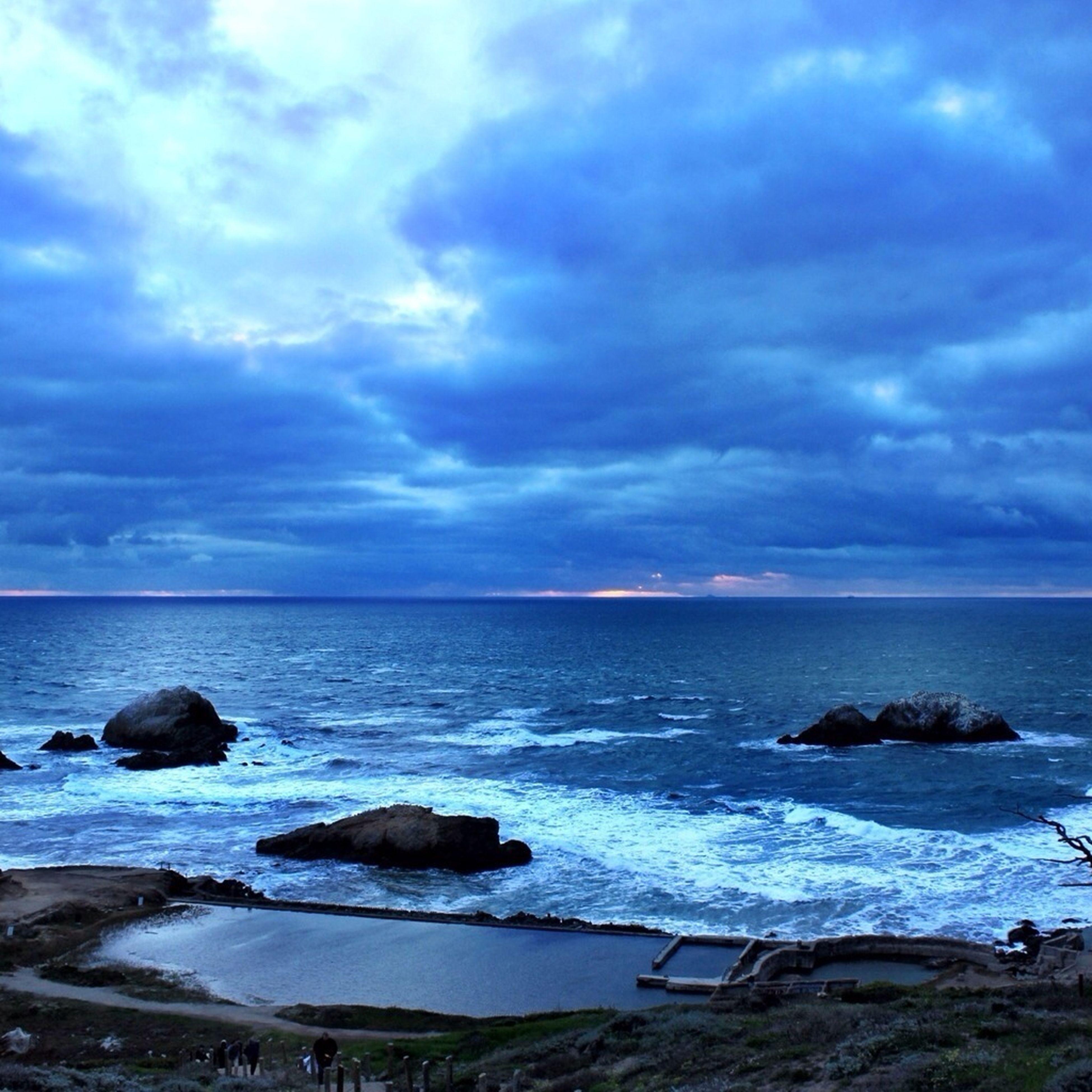sea, horizon over water, sky, water, scenics, tranquil scene, beauty in nature, beach, cloud - sky, tranquility, shore, cloudy, nature, cloud, blue, idyllic, coastline, rock - object, seascape, wave