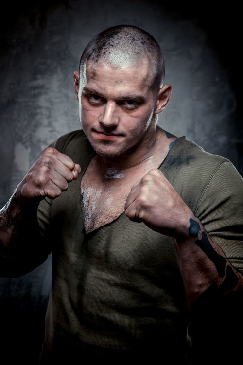 Portrait of muscular young man with dirty face and chest Aggressive Athlete Athletic Caucasian Gray Background Guy Handsome Man Muscle Muscular Muscular Build Muscular Man One Person Person Physique  Shaven Head Sport Sportive Strength Strong Young Adult