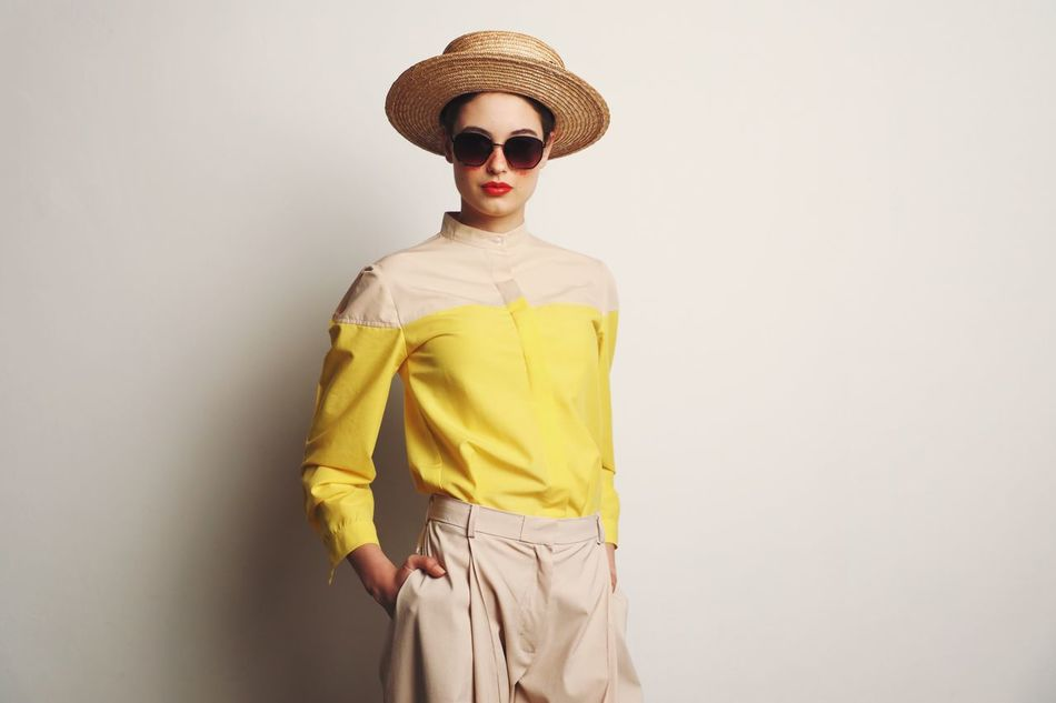The definition of the new summer chic Hat Real People Casual Clothing Lifestyles One Person Leisure Activity Yellow Standing White Background Cowboy Hat Indoors  Sombrero Day Summer Lifestyle Fashion Fashion&love&beauty