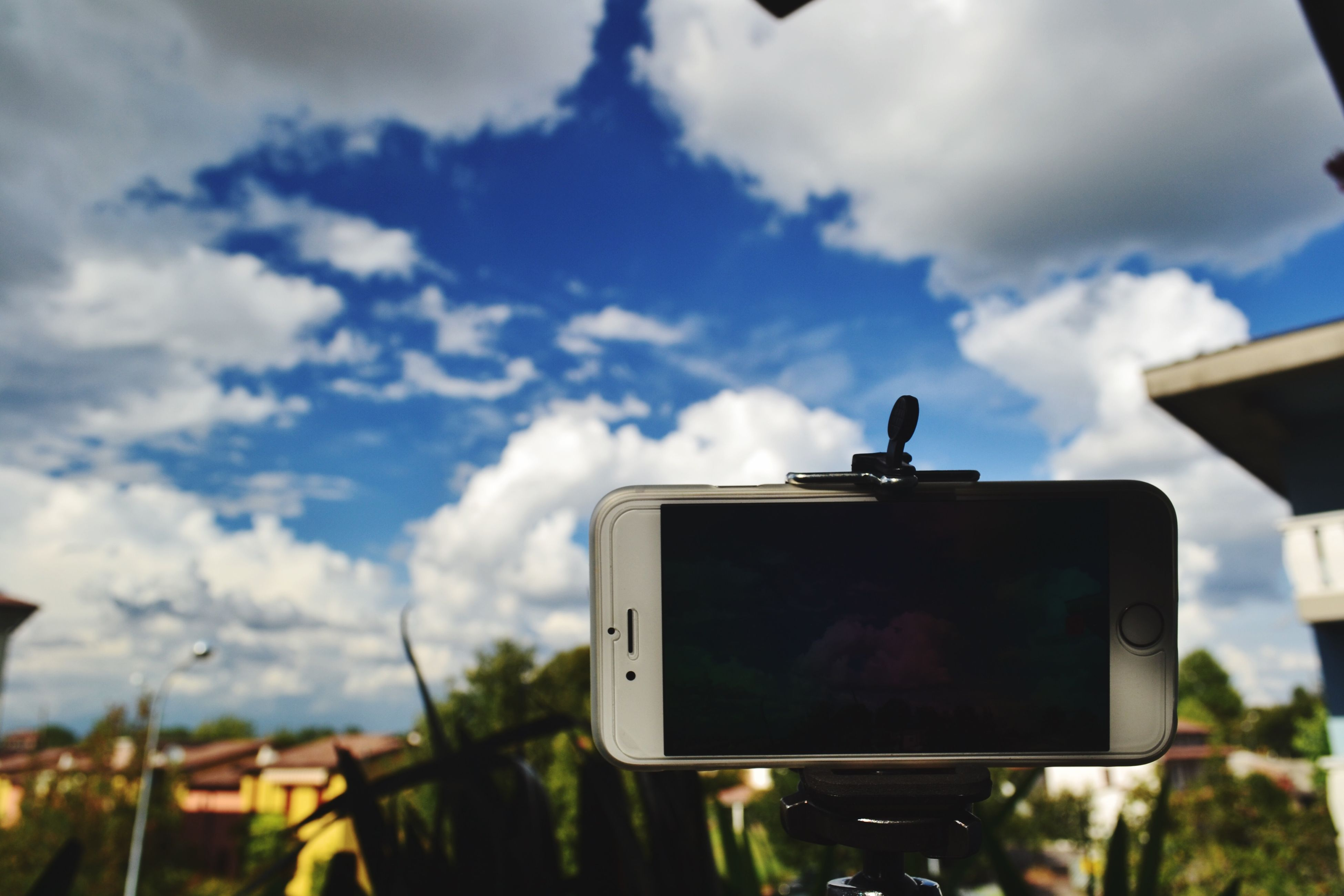 sky, photography themes, technology, camera - photographic equipment, focus on foreground, photographing, cloud - sky, cloud, field, digital camera, holding, landscape, men, nature, silhouette, outdoors, wireless technology, cloudy