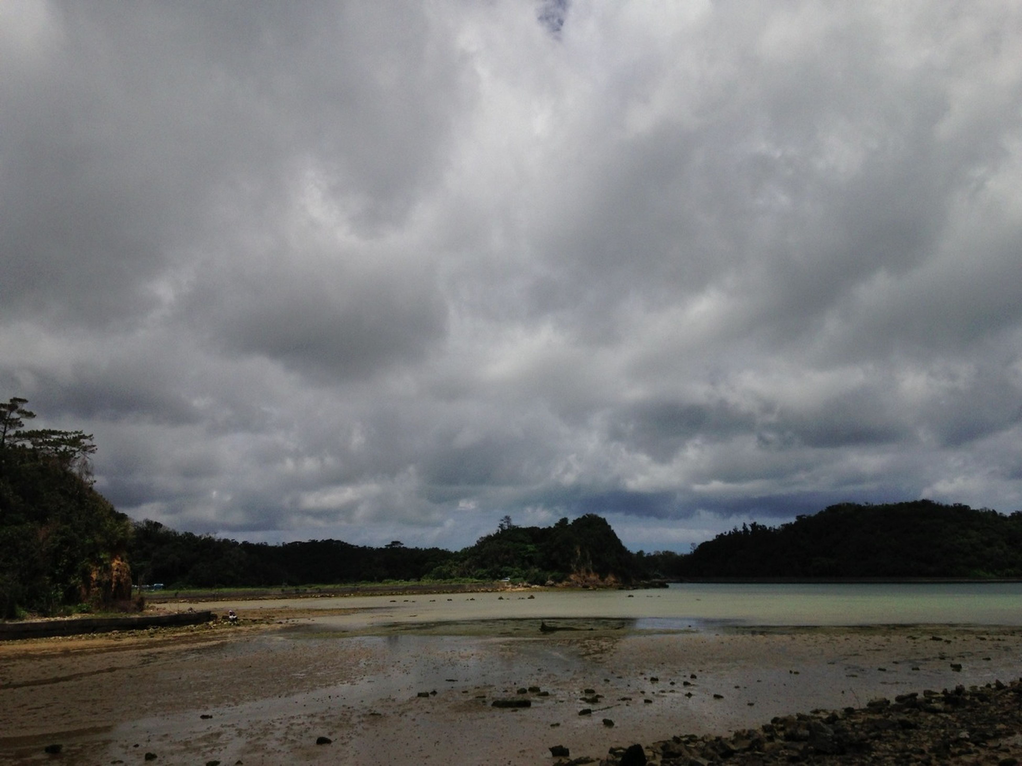 sky, cloud - sky, tranquil scene, tranquility, scenics, water, cloudy, beauty in nature, beach, nature, shore, weather, cloud, sand, overcast, mountain, sea, idyllic, non-urban scene, landscape