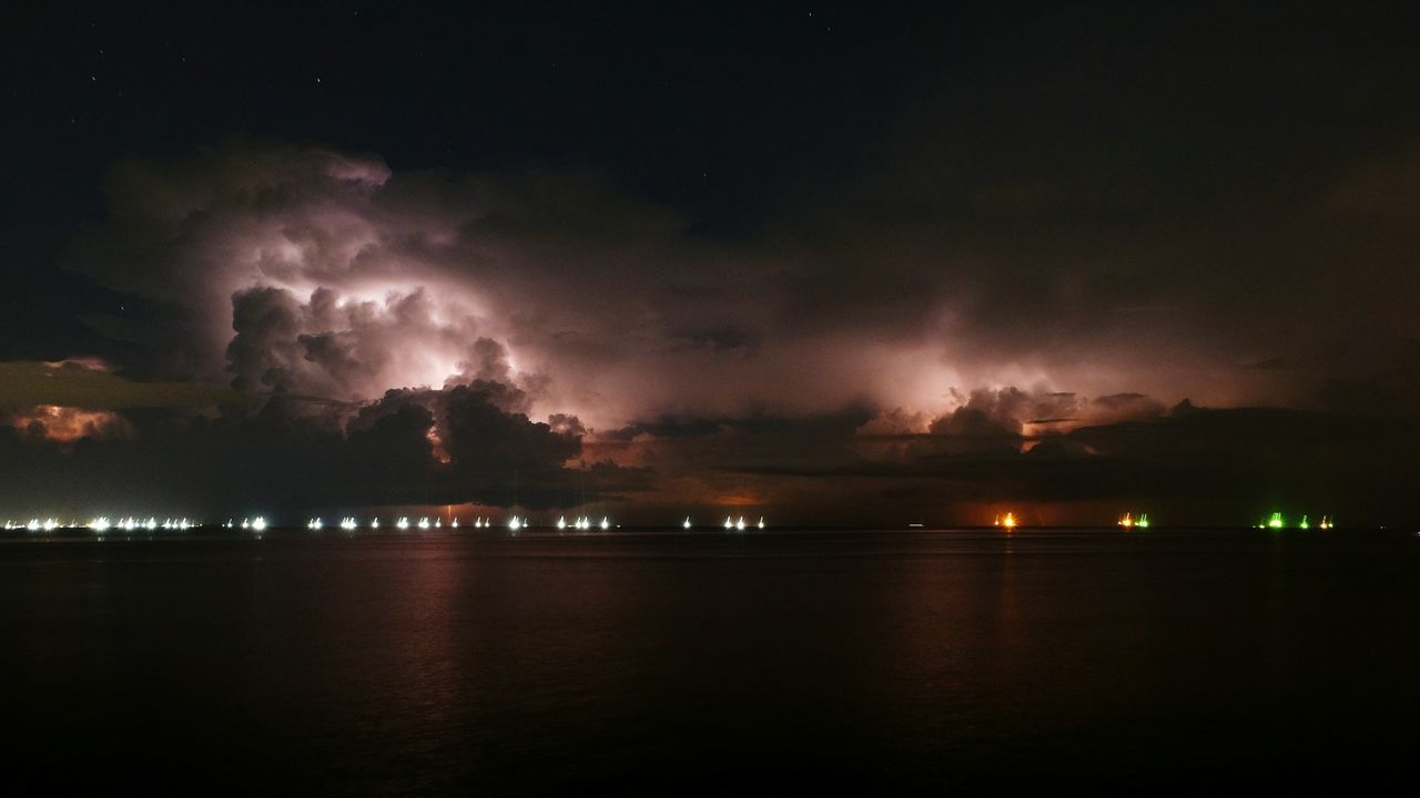 beauty in nature, sky, nature, night, scenics, weather, no people, cloud - sky, storm cloud, illuminated, tranquility, tranquil scene, thunderstorm, water, outdoors, lightning, sea, power in nature, forked lightning