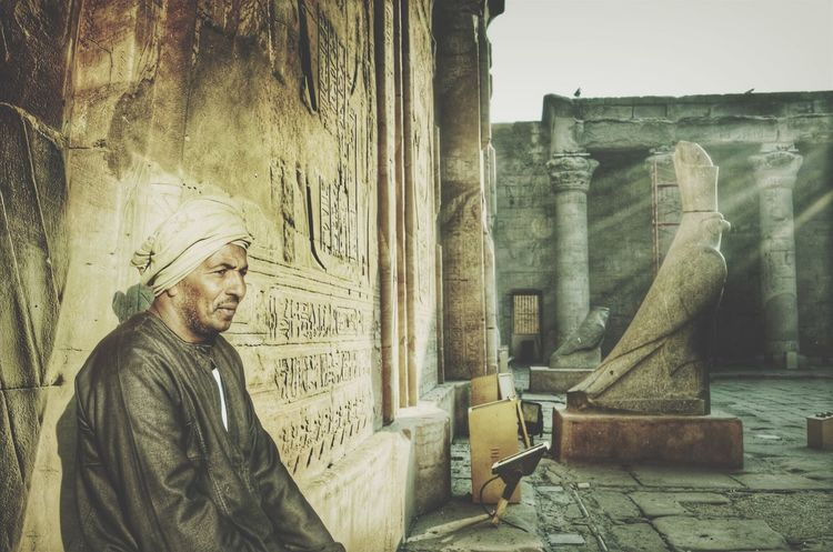 "I Love My City The local people who guard (Edfu temple "" built 237 BC"") are giving the place a special vibe and genuine sensation. ( Edfu Temple , Egypt ) City Life City History People People Photography People Watching Tadaa Community"