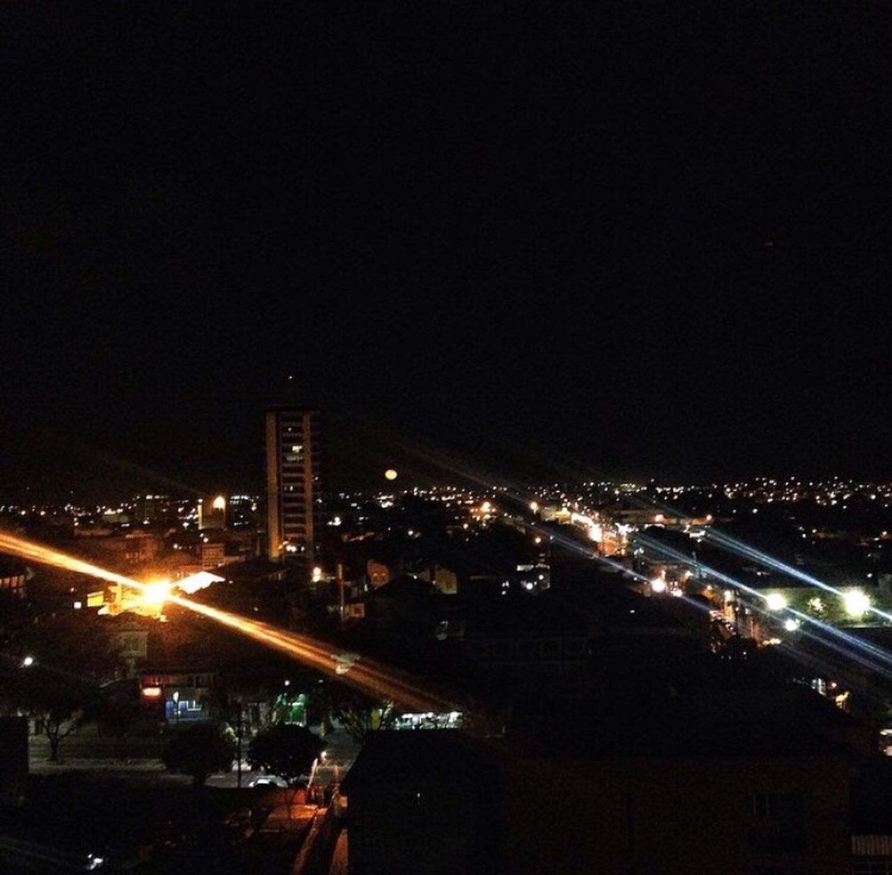illuminated, night, city, architecture, building exterior, built structure, transportation, outdoors, cityscape, no people, clear sky, sky