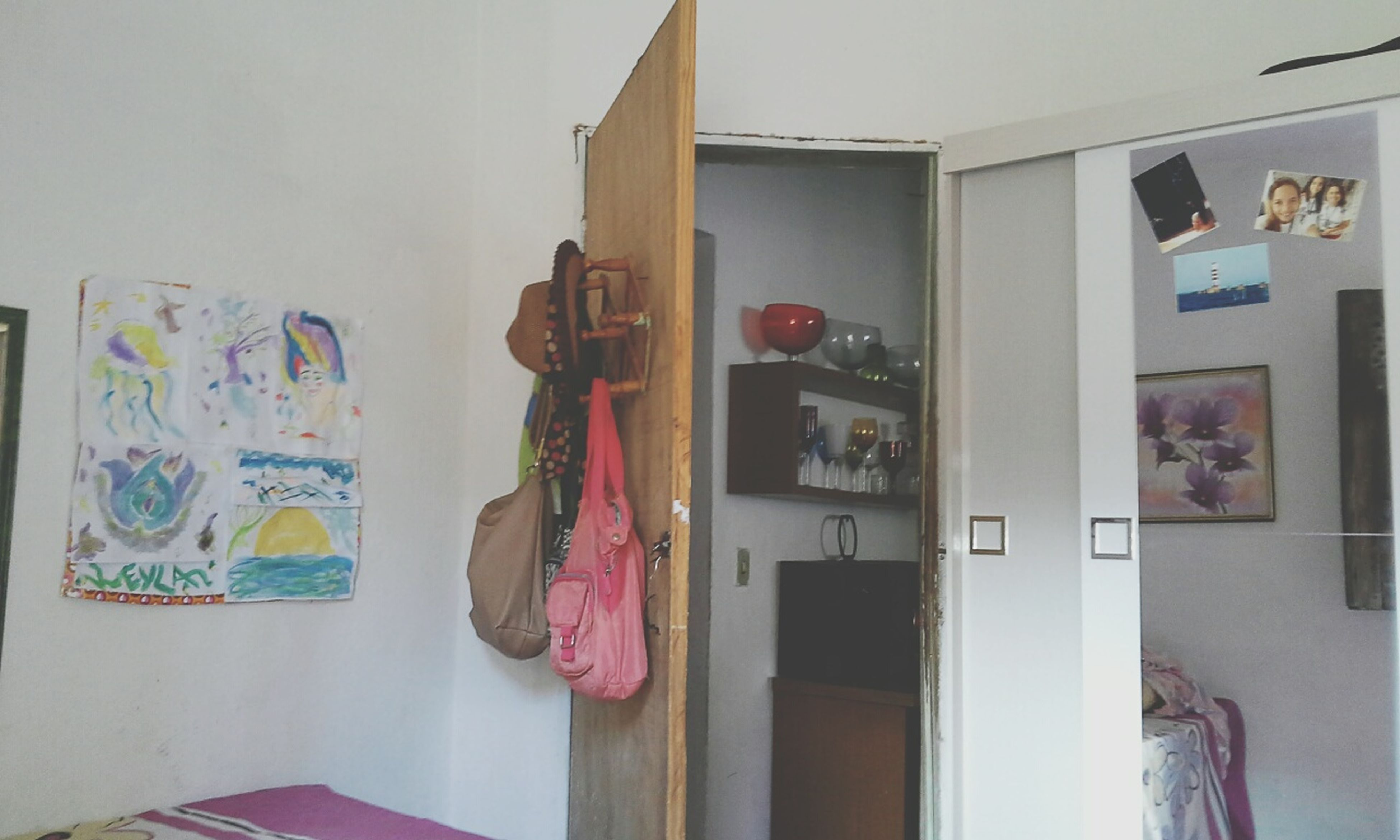 indoors, variation, hanging, wall - building feature, multi colored, art, art and craft, built structure, creativity, architecture, home interior, wall, window, door, store, clothing, human representation, choice, curtain, house