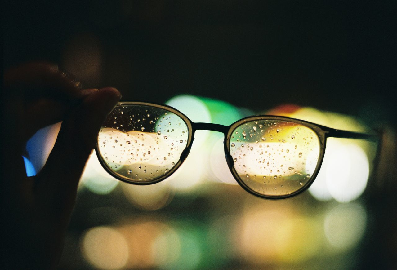 Rainy Day. Close-up Day Drink Eyeglasses  Focus On Foreground Freshness Glasses Human Body Part Human Hand Illuminated Indoors  People Rain Rainy Days Real People Water
