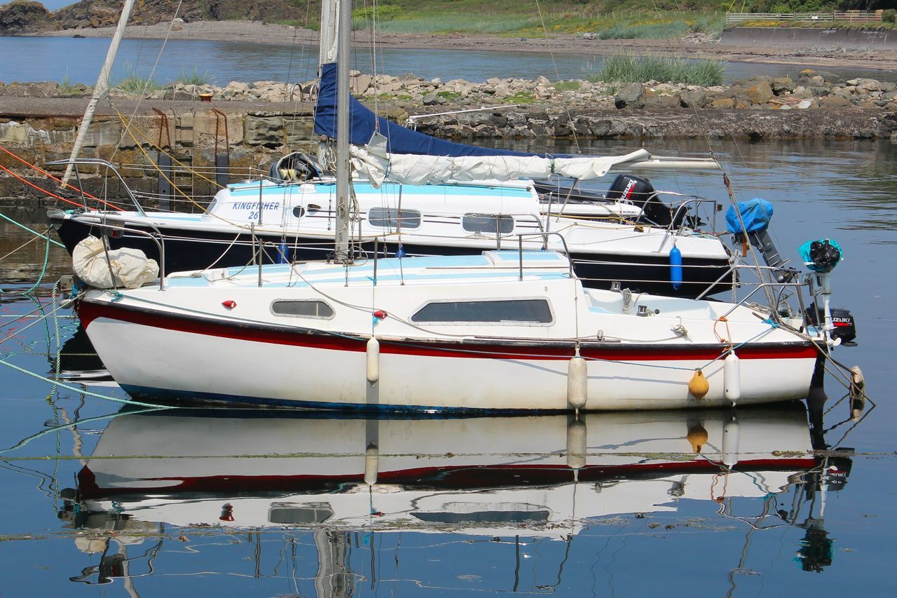 nautical vessel, transportation, moored, mode of transport, water, boat, reflection, rope, nature, day, outdoors, no people, motorboat, sea, harbor, waterfront