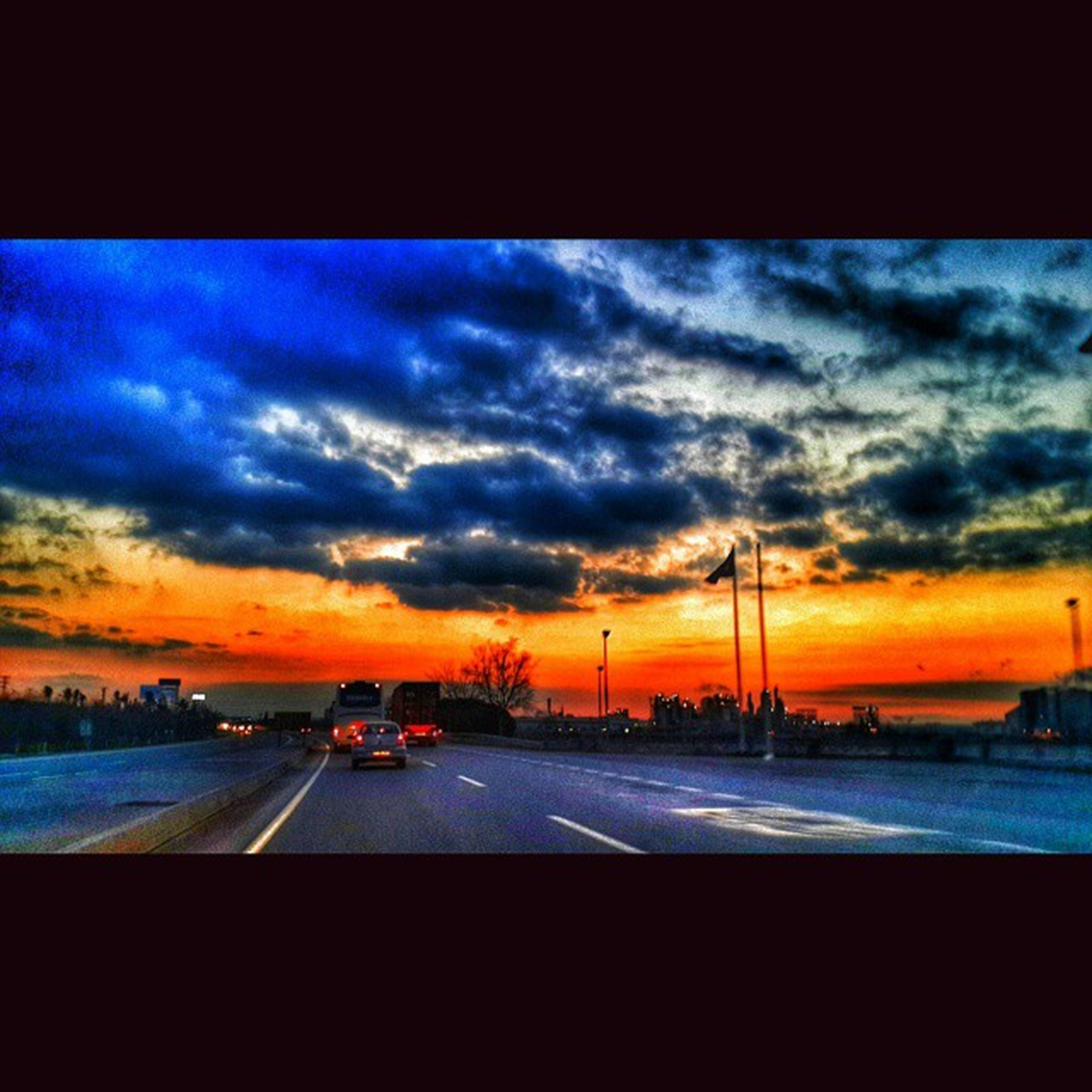 sunset, transportation, sky, cloud - sky, orange color, mode of transport, dramatic sky, road, cloudy, car, cloud, transfer print, scenics, land vehicle, beauty in nature, auto post production filter, dusk, nature, travel, silhouette