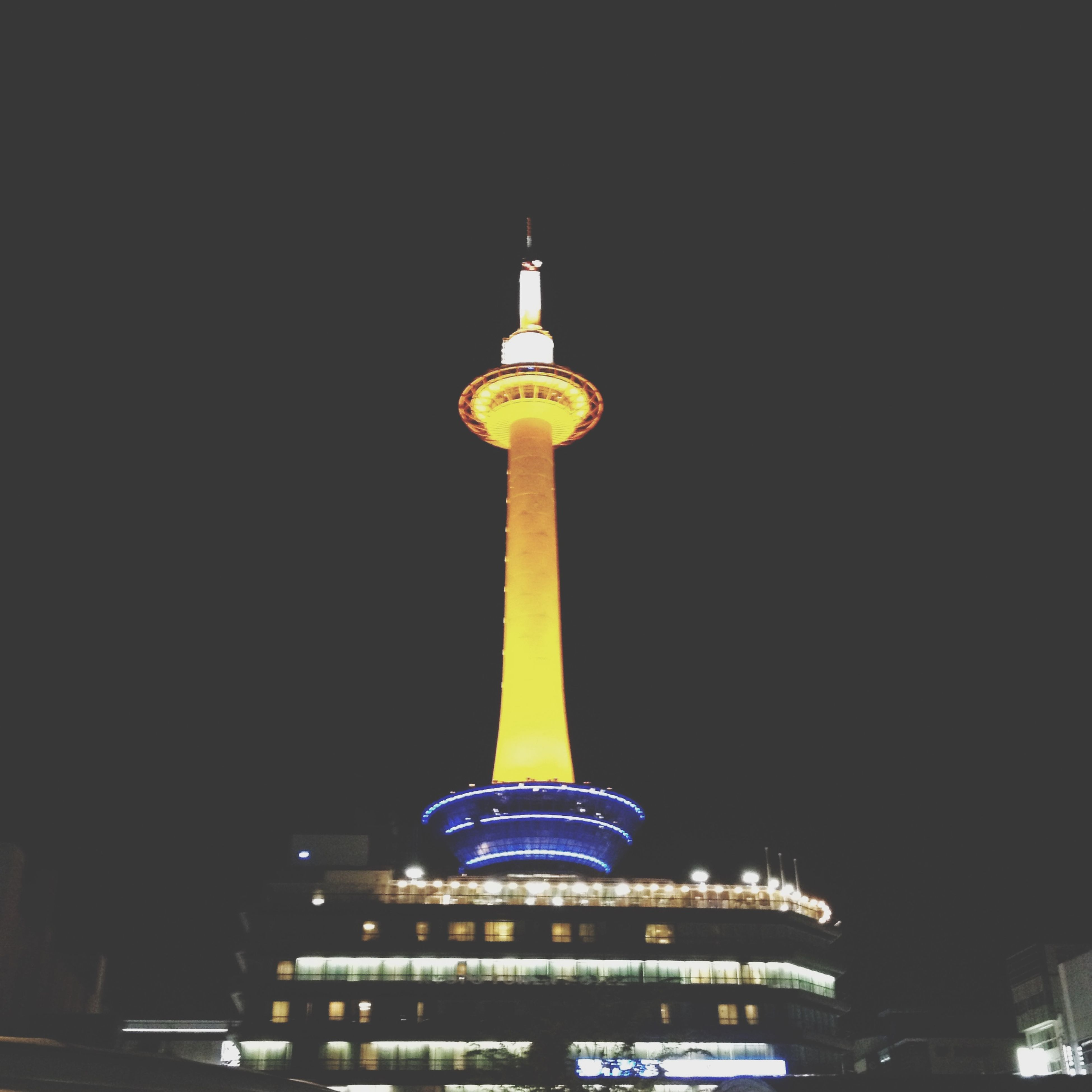 architecture, built structure, building exterior, tower, illuminated, international landmark, famous place, communications tower, night, travel destinations, tall - high, capital cities, spire, low angle view, tourism, travel, clear sky, communication, city, culture